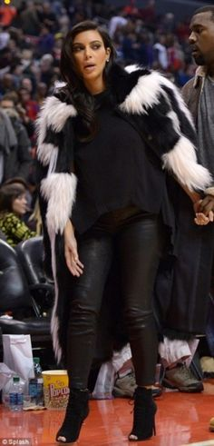 Kim Kardashian wearing J Brand Agnes Low Rise Zipper Skinny Jean, Tom Ford Fall 2011 Ankle Boots and Fendi Fall 2012 Fur Coat.