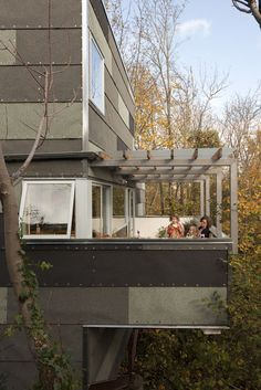 Hale/Edmonds Residence, Seattle...The exterior is a mix of asphalt roll roofing, SnapLock metal panels, and Hardipanel.