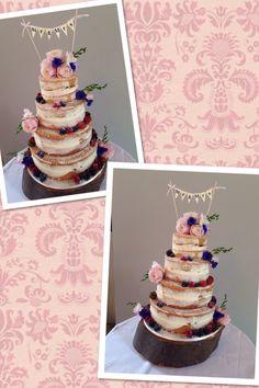 Naked wedding cake with fruit & fresh flowers