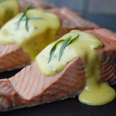 """Poached Salmon with No-Fail Hollandaise   """"Everyone needs an easy, simple and elegant meal that provides great leftovers (think salmon salad, salmon cakes, salmon aspic). No one poaches fish anymore, but it's the ultimate feed-a-crowd meal.""""—Andrew Zimmern"""
