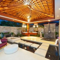 This exquisite Balinese-inspired home in Hawaii features a heavenly private outdoor spa bathroom!