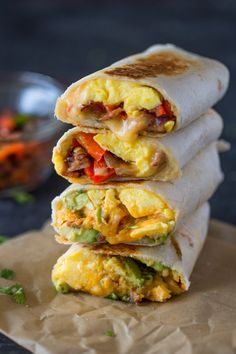 Scrambled eggs, crispy bacon, bell peppers and cheese wrapped in tortillas and toasted until the cheese is melted and gooey and the outside is crispy. These tasty burrito wraps are perfect for brea…