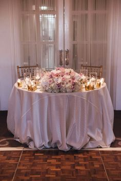 Sweetheart Table Arrangement Centerpiece, Roses, orchids, hydrangea, stock, calla lilies, gold mercury candles.  Florals By Jenny: Blush White and Gold at The Ritz Carlton, Laguna Niguel- 11.01.2014