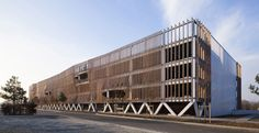 This multi-storey car park in Soissons, France, by Paris firm Jacques Ferrier Architectures has an undulating facade of vertical timbers. Parking Building, Building Facade, Building Design, Car Parking, Parking Lot, Industrial Architecture, Facade Architecture, School Architecture, Landscape Architecture