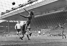 Spurs & N. Ireland Goalkeeper Pat Jennings acrobatically, saves a shot during a game between Spurs and Liverpool at Anfield in 1973