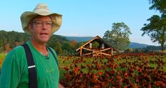 Joel Saiatin with his movable chuck shed, pasture raised goodness.
