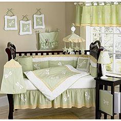 This dragonfly themed nine piece baby bedding set was created by JoJo Designs. This set includes a blanket, crib bumper, crib skirt, fitted sheet, toy bag, decorative throw pillow, diaper stacker, and two window valances.