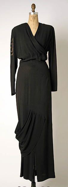 Dress Designer: Gilbert Adrian (American, Naugatuck, Connecticut 1903–1959 Hollywood, California) Date: ca. 1945 Culture: American Medium: rayon, metal
