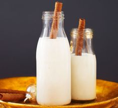 This creamy coconut cocktail, with vanilla vodka and warming nutmeg, is a perfect Christmas party tipple - serve in mini milk bottles with a chocolate wafer straw