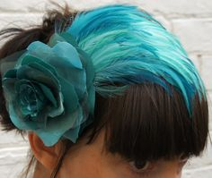 teal - a feather in her cap