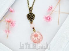 #Pink Real Flower Resin Necklace Dried Flower Pendant - Resin Ball Botanical Orb Eco Friendly Jewelry Statement Pendant Transparent Necklace  Handcrafted necklace featuring beautiful star flowers encased in non toxic resin orb. The necklace is accompanied by glass bead and lovely flower charm. Its perfect for your everyday wearing or special unique gifts!  *The necklace measures approx 19 5/8 inches (50cm) long antique gold tone chain *Head orb is 43/64 inches(17mm).  + If youd like the…