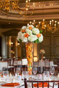 towering orange & white wedding centerpiece of hydrangeas & roses + submerged orchids / Koru Wedding Style: {Orange & White Florida Wedding} Soliane & Mackendy