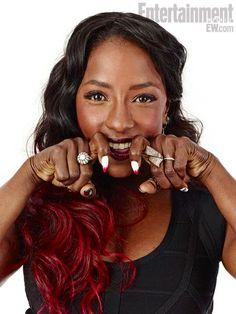 Rutina Wesley showing off her Vampire Shaped Nails