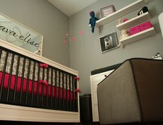 Mixing brown, gray and hot pink adds sophistication to this nursery. A mirror with the baby's name in swirly script is a great idea (and can stay even when she gets older!). Submitted by Marisa S.