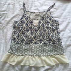SALE! Tulip-back tank top! This beautiful tank top has a great blue and cream pattern, with a Ruffles hem and tulip back. Perfect for spring/summer! Paper Crane Tops Tank Tops