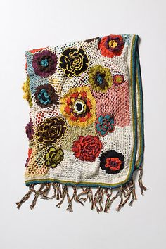 Knitted afghan throw with bright 3d flowers