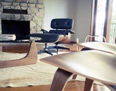 Herman Miller classics in Walnut - #Eames LCW, Eames Lounge and Ottoman, and Isamu Noguchi . #MCM