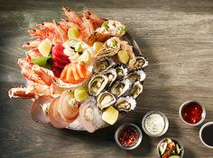 The Atlantic Seafood Platter - a selection of freshly sliced sashimi, freshly shucked oysters, whole prawns, crab leg, scallops in the shell with lime aioli and Moreton Bay Bugs with cocktail sauce #sashimi #seafood #prawns #scallops #oysters #moretonbaybugs