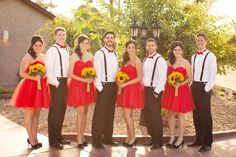 bridesmaids in red with sunflower bouquets and groomsmen with red bow-ties. #perfection