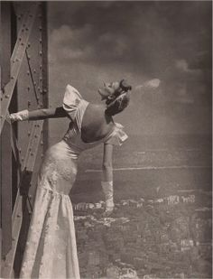 Harpers Bazaar 1939 -- model on the Eiffel Tower wearing Mainbocher.