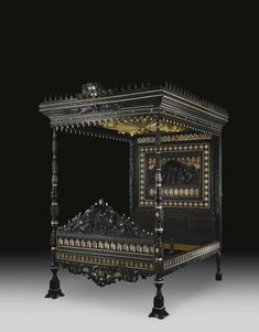 A fine and rare Anglo-Indian carved and inlaid ebony, faux tortoiseshell and ivory four-poster tester bedstead Composed of late 17th century and early 19th century elements