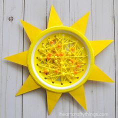 This paper plate sun craft makes a perfect summer sewing craft for kids, summer kids craft, beginning sewing craft for kids and paper plate summer crafts.