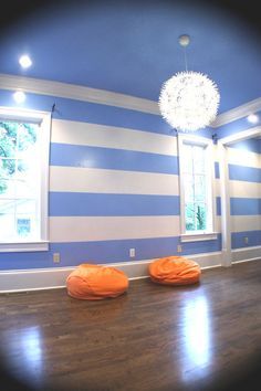 this room looks finished & it is virtually empty! it is that painted ceiling - striped wall