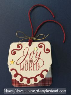 You can make this tag with Stampin Up's Cheerful Tags Framelits. Easy. Visit my blog