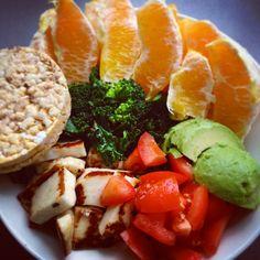 ❝Another yummy lunch - halloumi, kale, broccoli, avocado, tomato, an orange & rice cakes.❞
