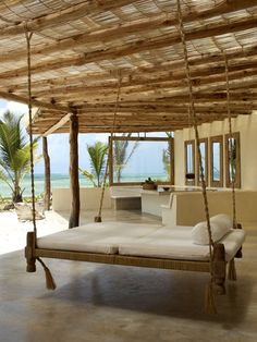 Hanging bed on a patio by the sea....well, no sea. How about, hanging in the breeze, Dan?
