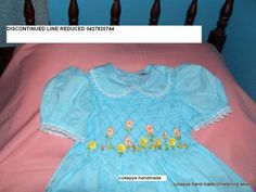 ONE OFF design smocked with hand embroidered flowers in ribbon embroidery size 4 cost is $149