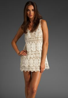 In white or black, this works as a cover up on the beach, or with a slip underneath as a dress for date night