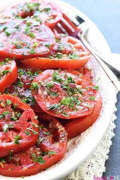 The BEST Marinated Tomatoes ~ ripe, juicy tomatoes soak up olive oil, red wine vinegar, onion, garlic, & fresh herbs in this zesty summer salad.