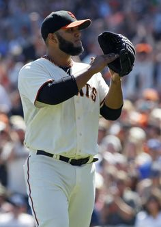 San Francisco Giants pitcher Yusmeiro Petit claps after a successful double play against the Los Angeles Dodgers during the first inning of a baseball game, Sunday, Sept. 14, 2014, in San Francisco. (AP Photo/George Nikitin)