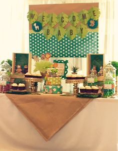 Jungle theme baby shower table. Table design and decor by Glam Candy Buffets! Cake by Lady Wright's Delights!