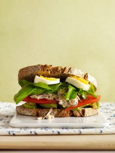 Sardine Salad Sandwich: Rich, delicious sardines mashed with canola mayonnaise are the foundation of a formidable tower of nutrients, including sliced avocado, hard-boiled egg, tomato, and arugula. Double-click for the recipe
