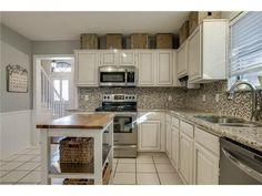White kitchen // Square tile backsplash