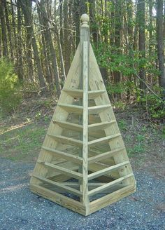Building the 6 ft. strawberry pyramid. I like the height, and the compactness of this idea.