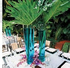 Palm Leaf Center Pieces http://pics.boards.weddingbee.com/61389.palm_leaves_centerpiece.jpg
