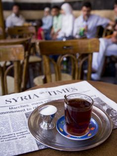 Drinking Tea in the Famous Al Nawfara Cafe in Old Damascus, Syria  by Julian Love