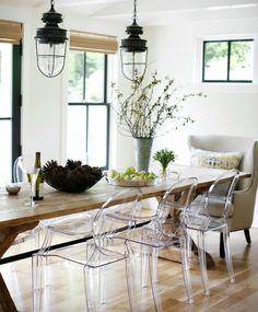 wood table + clear acrylic chairs
