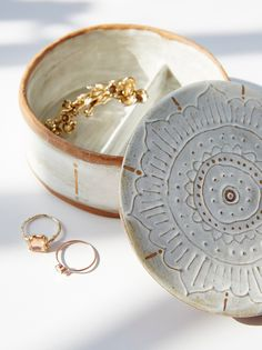 Small Round Jewelry Box | Beautiful handmade circular shaped ceramic jewelry box featuring a metallic painted top. Inside is divided to easily stay organized. American made.