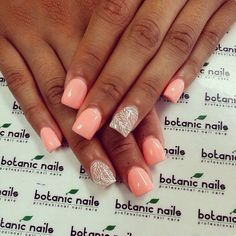 Light pink polish with a delicate accent nail