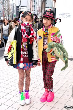 Here are two super-fun Harajuku girls who we met near Takeshita Dori. They both have gravity-defying braids and teeth stuck to their heads (really). In addition, they are wearing God Harajuku & hot pink creepers. Tokyo Street Fashion, Tokyo Street Style, Japanese Street Fashion, Japan Fashion, Korean Fashion, Japan Street, Harajuku Japan, Harajuku Girls, Harajuku Fashion