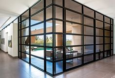 Replace exterior walls with large expanses of glass, using Western's 600 Series window walls that integrate hinged windows, operable sliders, hinged doors, sliding doors and more into one continuous wall of glass. Photo courtesy of Western Window Systems.