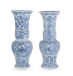 A pair of blue and white 'phoenix-tail' vases, Kangxi period (1662-1722)