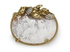 A shell cameo and diamond brooch, Webb battle scene carved cameo in a shell motif frame; signed Webb; mounted in eighteen karat gold.