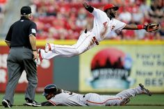 Steal and a save -        San Francisco Giants' Brandon Crawford, bottom, steals second base against Cincinnati Reds second baseman Brandon Phillips in the second inning May 15 in Cincinnati. The Giants won 10-2. - © John Minchillo/AP