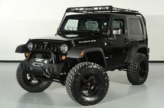2010 Jeep Wrangler Rubicon with Gobi Roof Rack: Front-Left View