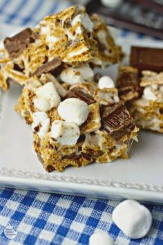These S'mores Krispie Treats will be a huge hit! Crispy graham cereal, soft marshmallows and chocolate all coated in gooey marshmallow. Who could say no?